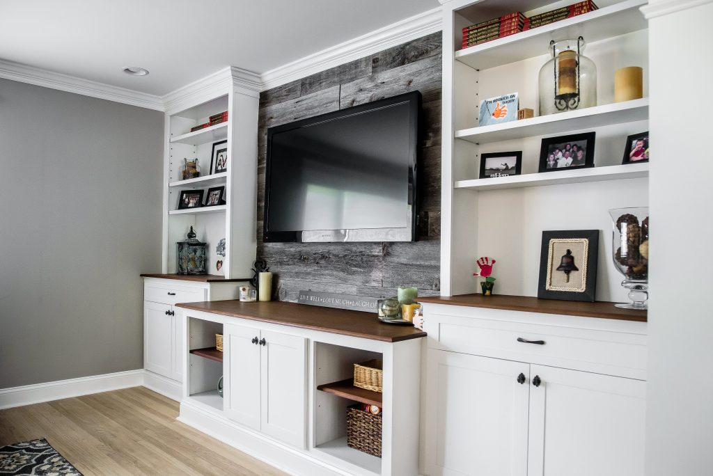 white cabinets, tv in middle